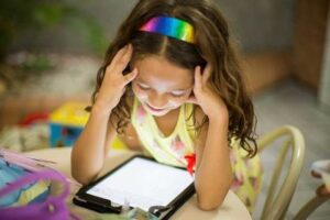 Kid watching at Tablet screen
