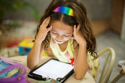 Kid watching at Tablet screen